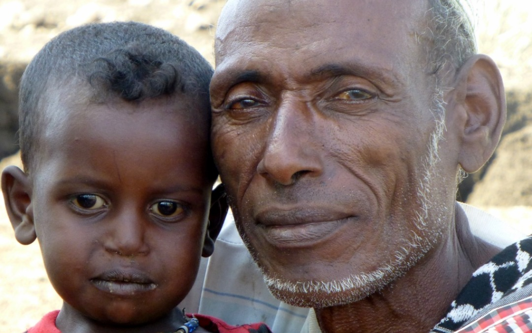 Muusa from rural Ethiopia with his three year old daughter