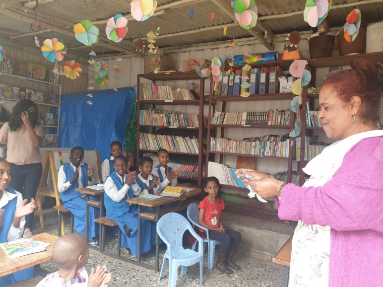 Maria Munir, AWSAD Executive Director, reading Ethiopiaid's messages to children at the safe shelter