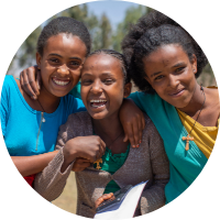 Ethiopian school girls smiling - your monthly donation to Ethiopia can power equal education