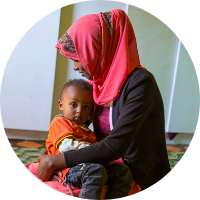 Ethiopian mother and baby son - start your monthly donation to Ethiopia to help end obstetric fistula