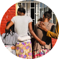 A group of women and children at the safe shelter - your monthly donation to Ethiopia provides food, shelter and hope for survivors of gender-based violence